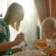 Mother Helping Her Son In Having Lunch - VideoHive Item for Sale