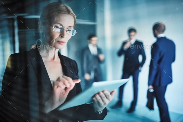 Confident businesswoman at work - Stock Photo - Images