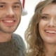 Couple In Santa Hat Smiling And Laughing - VideoHive Item for Sale