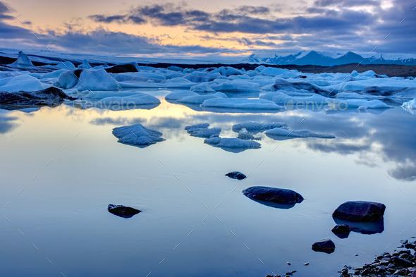 The Jokulsarlon lagoon at midnight  - Stock Photo - Images
