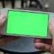 Smart Phone Held By Hand. Green Screen Chroma Key - VideoHive Item for Sale