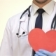 Smiling Male Doctor With a Paper Heart - VideoHive Item for Sale
