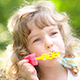Happy Child Playing With Soap Bubbles - VideoHive Item for Sale