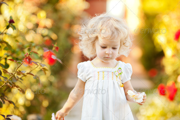 Beautiful child in garden - Stock Photo - Images