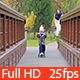 Child Riding a Scooter on the Bridge - VideoHive Item for Sale