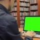 Young Handsome Man Sits And Works On Green Screen - VideoHive Item for Sale