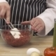 Chef Mixing Meat In a Glass Bowl In The Kitchen - VideoHive Item for Sale