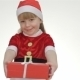 Kid Girl Offering a Gift In a Red Box - VideoHive Item for Sale