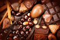 Luxury chocolates background. Praline chocolate sweets - PhotoDune Item for Sale