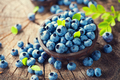 Blueberry on wooden background. Ripe and juicy fresh picked blue - PhotoDune Item for Sale