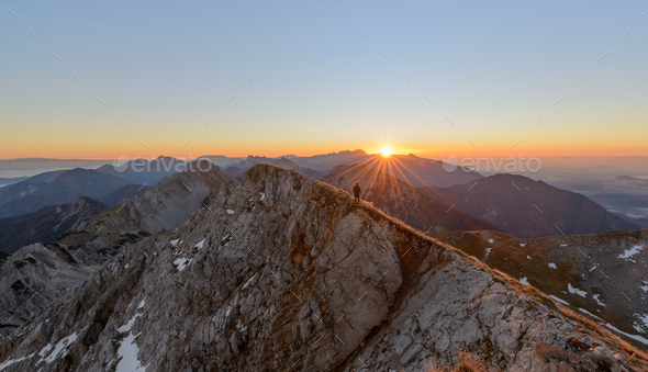 Male hiker at the top of the big mountain at Sunrise - Stock Photo - Images