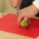 Chef Cutting And Slicing Pear On a Cutting Board - VideoHive Item for Sale
