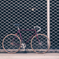 Road bicycle and concrete wall, urban scene vintage style - PhotoDune Item for Sale