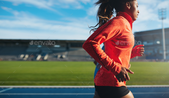 African female athlete training on race track - Stock Photo - Images