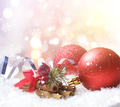 Christmas background of decorations nestled in snow - PhotoDune Item for Sale