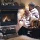 Woman Sitting In a Rocking Chair Near Fireplace - VideoHive Item for Sale