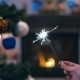 Sparklers On The Background Of Christmas Tree - VideoHive Item for Sale