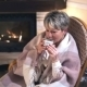 Mature Woman Drinking Coffee In a Cozy Living Room - VideoHive Item for Sale