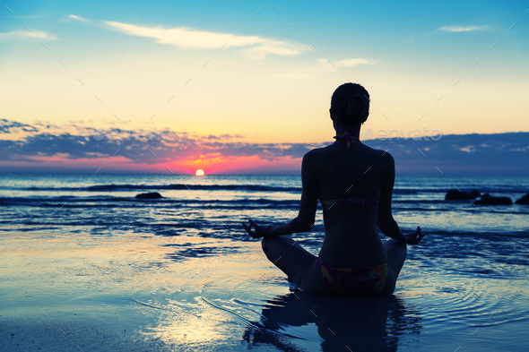 Meditation on the beach - Stock Photo - Images