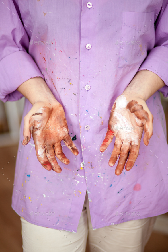 The girl with painted hands - Stock Photo - Images