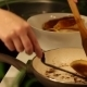 Placing Homemade Cakes In The Pan For Frying - VideoHive Item for Sale