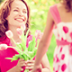 Child Giving Flowers To The Young Woman - VideoHive Item for Sale