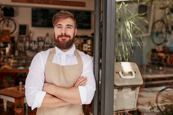 Handsome and confident cafe owner - Stock Photo - Images