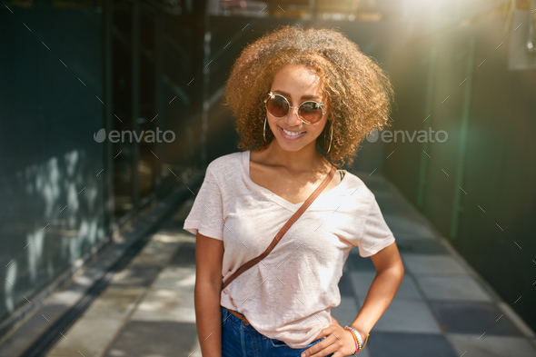 Attractive young woman posing outdoors - Stock Photo - Images