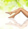healthy sexy slender female legs over green natural spring backg - PhotoDune Item for Sale