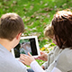 Family Using Tablet PC In Autumn Park - VideoHive Item for Sale