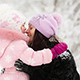 Woman And Child Playing With Snow In Winter - VideoHive Item for Sale
