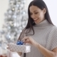 Smiling Young Woman Opening a Christmas Present - VideoHive Item for Sale