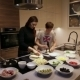 Sister And Brother In The Kitchen Preparing Pizza - VideoHive Item for Sale