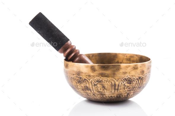 Nepali singing bowl isolated in white - Stock Photo - Images