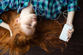 Woman lying on floor and listening to music - PhotoDune Item for Sale