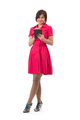 girl in a red dress with a Tablet PC - PhotoDune Item for Sale