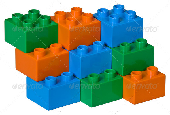 Blue, green and orange plastic toy bricks - Stock Photo - Images