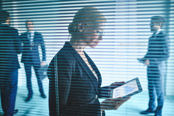 Businesswoman behind jalousie - Stock Photo - Images