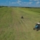 Aerial Footage Of a Tractor In Field Russia - VideoHive Item for Sale