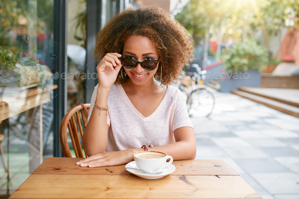 Pretty young girl at outdoor cafe - Stock Photo - Images