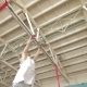 Gymnast Spins On Horizontal Bar At The Gym - VideoHive Item for Sale