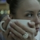 Young Woman Drinking Tea And Smiling At Camera - VideoHive Item for Sale