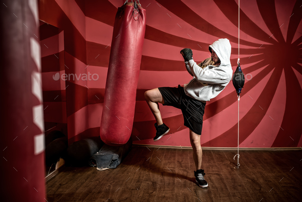 Boxer and athlete training and practicing kicks in the gym - Stock Photo - Images