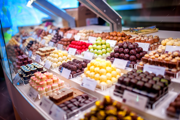 chocolate truffes, candies and sweets store on showcase in factory - Stock Photo - Images