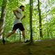 Man In Sportswear Running Through Trees - VideoHive Item for Sale