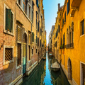 Venice sunset in water canal and traditional buildings. Italy