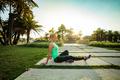 Woman training in urban park - PhotoDune Item for Sale