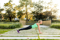 Woman training in urban park at sunset - PhotoDune Item for Sale