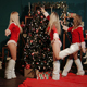 Girls in Santa Claus Costumes Decorating Xmas Tree - VideoHive Item for Sale