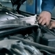 Mechanic Fixing a Problem With The Engine - VideoHive Item for Sale